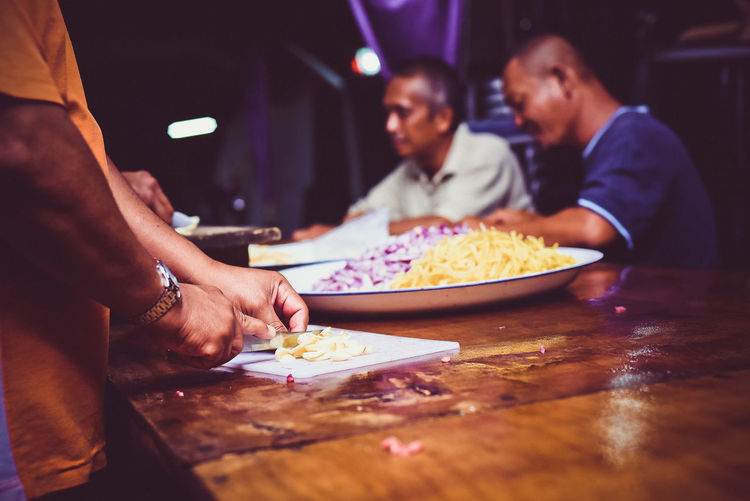 Garlic Business Eating Food Food And Drink Food Preparation Friendship Ginger Lifestyles Malay Dish Malay Style Onion Sitting Slicing Togetherness