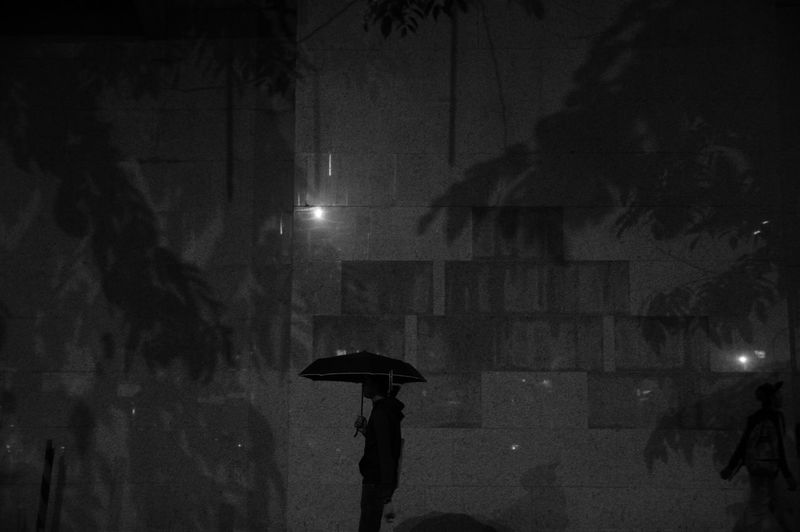 Under My Shangri-La Black And White Wall Night Street Night Scene Alone Pedestrian Solidarity Lost Lightning Under Men City Thunderstorm Torrential Rain RainDrop Wet Protection Below Monsoon Sheltering Rain Rainfall Umbrella Rainy Season