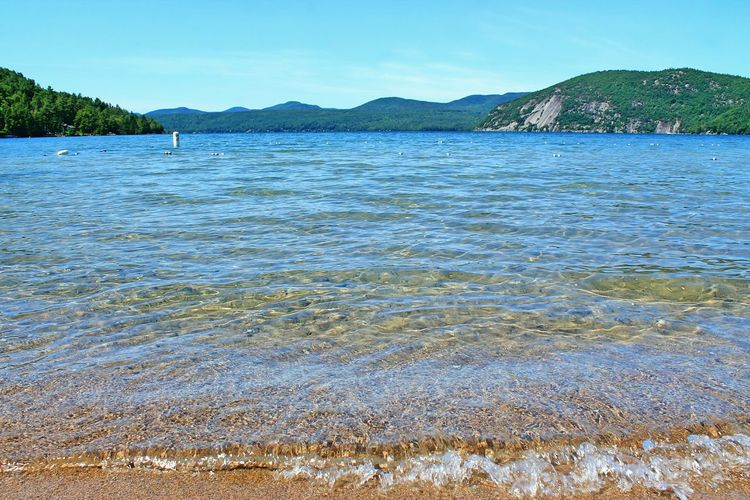 Beach Clear Water Lake Lake George NY Mountains In Background Upstate Water Wave