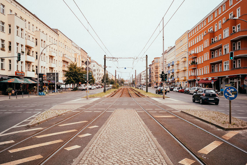 Urban perspectives Perspective Public Transportation The Street Photographer - 2018 EyeEm Awards Tram Urban Geometry Architecture Building Building Exterior Built Structure City City Street Clear Sky Day Diminishing Perspective Direction Mode Of Transportation Outdoors Road Sky Street Symmetry The Way Forward Tramway Transportation Urban Skyline
