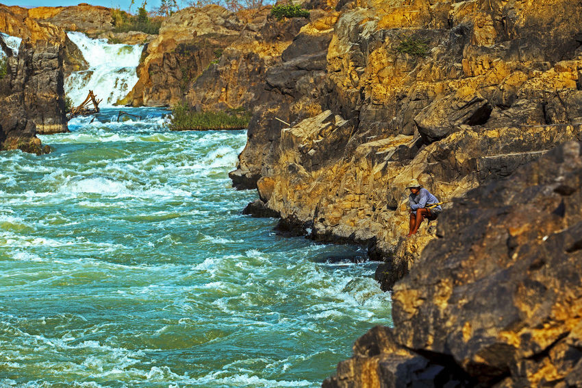 Si Phan Don – Stunning 4000 Islands beautiful and crazy river at Champasak of the Mekong in Laos Adventure Beauty In Nature Day Leisure Activity Lifestyles Men Nature Outdoors People Real People Rock Rock - Object Rock Formation Scenics - Nature Sea Si Phan Don Solid Sport Water