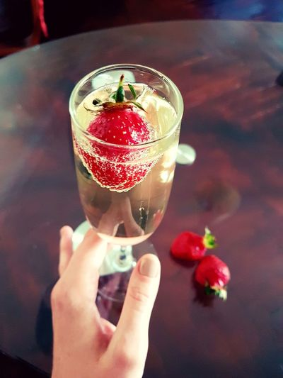 Drinking Glass Human Hand Food And Drink Table Personal Perspective Freshness Champagne Champagne Time Sparkling Wine Strawberry Berries Wine Not