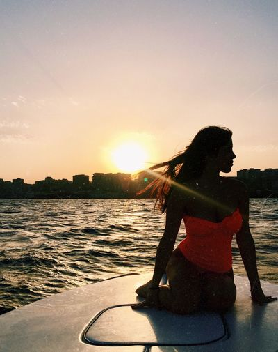 Colors Woman Profile Italy Sunset Shadow Ocean Sea Sky One Person Water Women Leisure Activity Real People Sunset Lifestyles Sunlight Hair Standing Outdoors Girls Silhouette