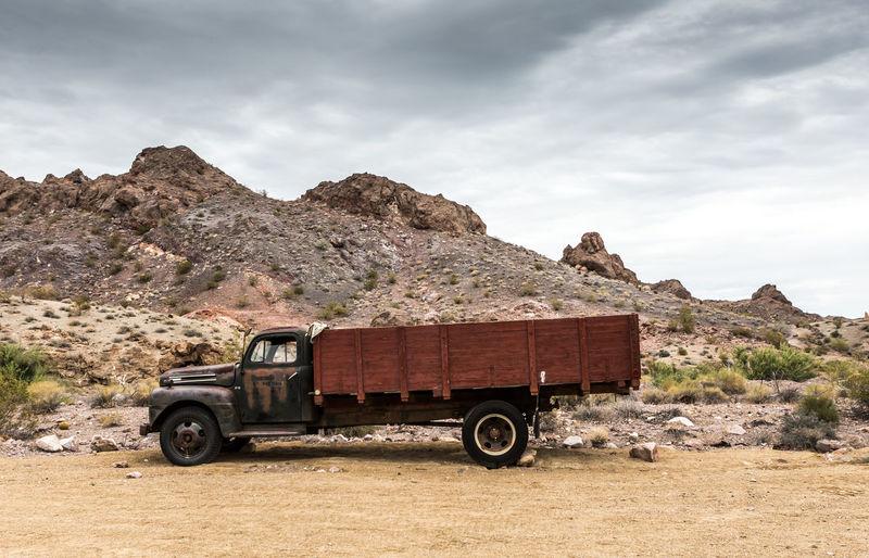 Vintage car against mountain range