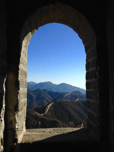 Scenic view of mountains seen through arch