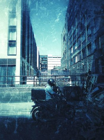 Artistic Grunge Motorcycle Bike Rider Clear Sky City Centre Traffic Riding Through City Manchester UK Stuck In Traffic Blue Sky Blurred Background Architecture EyeEmNewHere Urban Shadows & Light One Person Sidewalk Photograhy