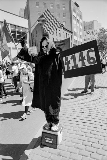 Protests at the 2008 Democratic National Convention (DNC) 2008 Democratic National Convention Black & White Film Protest Architecture Black And White Black And White Photography Blackandwhite Blackandwhite Photography Building Exterior Built Structure City Civil Disturbance Day Film Photography Full Length Large Group Of People Outdoors People Placard Protesters Protestor Real People Text Tri-x 400 Pushed Walking Women