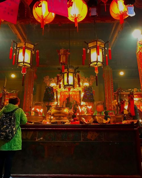 Man Mo Temple HongKong Hongkong Photos Hongkongphotography Illuminated Spirituality Religion Statue Night Indoors  Sculpture Real People Place Of Worship Men Food Altar Flower People
