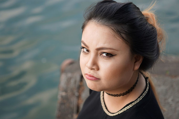 Angry Annoyed Asian  Day Face Girl Grumpy Lifestyles Making Faces Outdoors People Person Portrait Real People Sad Sullen Vietnamese Woman Young Adult Young Women
