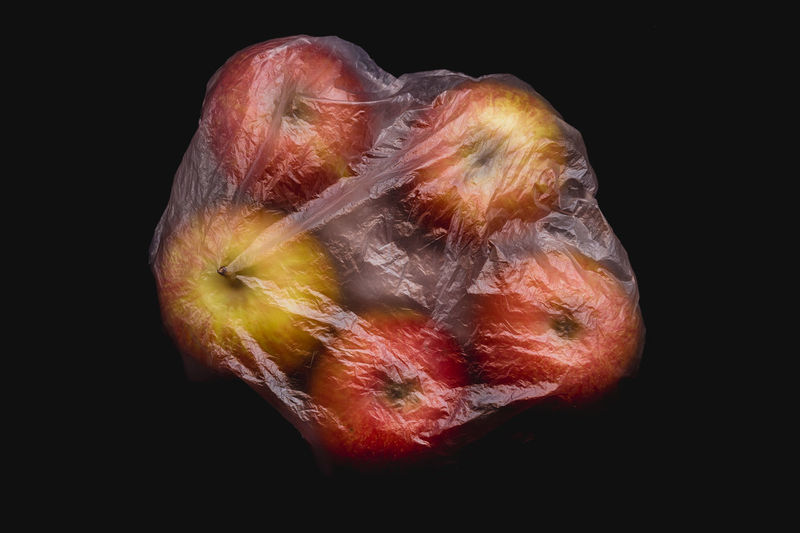 Red apples wrapped in plastic bag Bag Plastic Plastic Bag Food Fruit Fruits Organic Organic Food Vegetable Vegetables Closed Wrapped Plant Protection Red Store Supermarket Transparent Vitamin Juicy Juicy Fruit Nature Ripe Ripe Fruit Arrangement Bright Black Background Freshness Fresh Ingredient Ingredients Healthy Eating Healthy Food Cut Out Environmental Conservation Environmental Damage Buy Buying Inside Natural Condition Raw Food Diet Dieting Ready-to-eat No People Banana Apple Orange Wellbeing Still Life