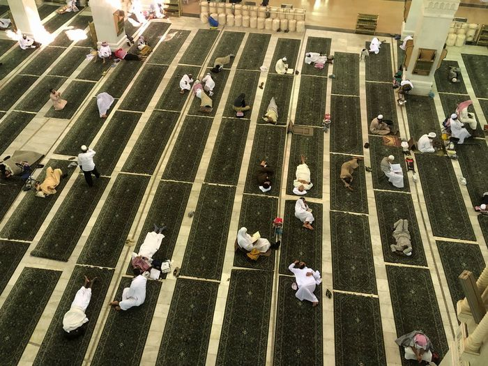 High angle view of people sitting on road
