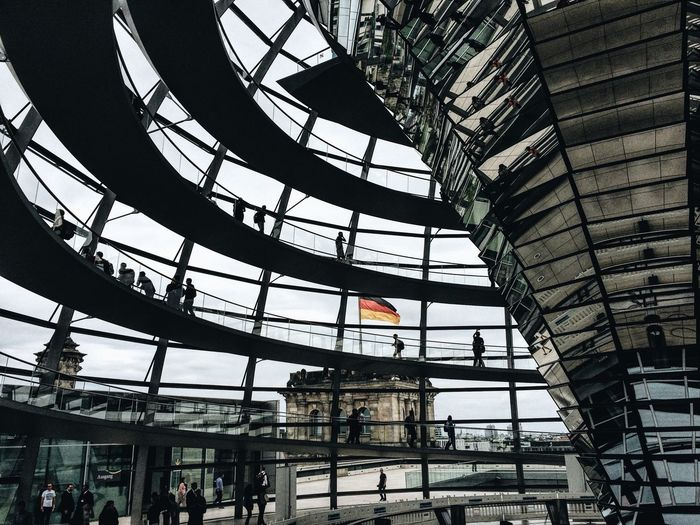 Architecture Built_Structure Building Exterior City Low Angle View Large Group Of People City Life Glass - Material Modern Famous Place Travel Destinations Parliament Building Tourism Government Building Development Capital Cities  Culture Day Outdoors Office Building Capture Berlin Neighborhood Map The Architect - 2017 EyeEm Awards Let's Go. Together. Berlin Love Your Ticket To Europe Discover Berlin My Best Photo