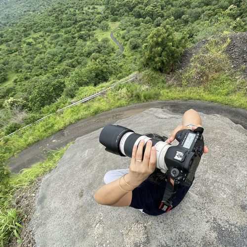High angle view of man photographing on road