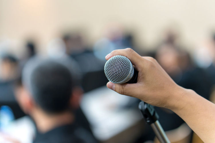 Adult Arts Culture And Entertainment Business Business Meeting Close-up Communication Conference - Event Focus On Foreground Group Of People Hand Human Body Part Human Hand Incidental People Input Device Meeting Men Microphone Music People Speech Stage Technology