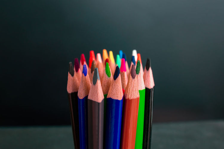 Close-up of multi colored pencils on table