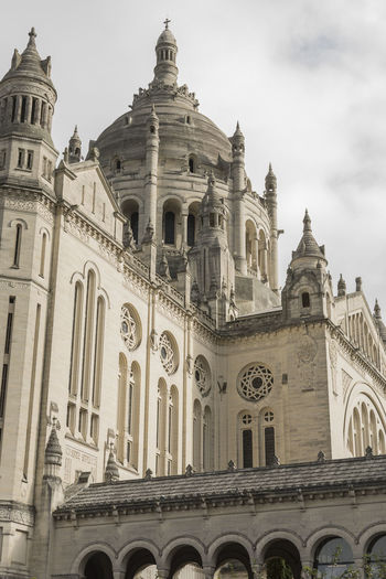 Basilica Of St Therese Lisieux Lisieux Basilica St Therese Architecture Building Exterior Built Structure Day Grey Sky History Low Angle View No People Outdoors Place Of Worship Religion Religious Building Religious Buildings Sky Spire  Spirituality Travel Destinations