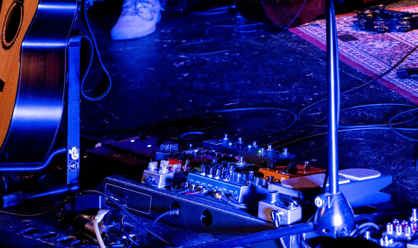 Concert Photography: Jazz Instruments: Workplace of A Guitarist (Lower Part) Indoors  Illuminated Night High Angle View Technology Blue Nightclub Occupation Nightlife No People Music Equipment Electrical Equipment Guitar Microphone Stand Acoustic Equipment Stage - Performance Space Stage Floor