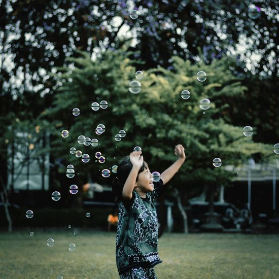 simple happiness Kids Being Kids Kids Having Fun Happiness A New Beginning Bubble One Person Mid-air Fragility Bubble Wand Vulnerability  Enjoyment