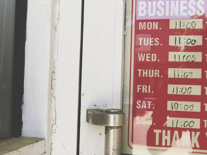 The Week on EyeEm Front Door Days Of The Week,  Door Handle Small Business Business Hours Business Text Communication Western Script Sign Wall - Building Feature No People Information Information Sign Day Close-up Red