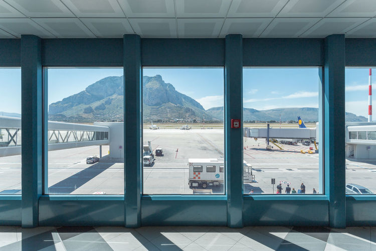 The Wait Of It All Airport Blue Sky Day In Transit Italy Light And Shadow Mountain Sicily Sky Sunny Symmetry Terminal Tourism Travel Vacations #FREIHEITBERLIN