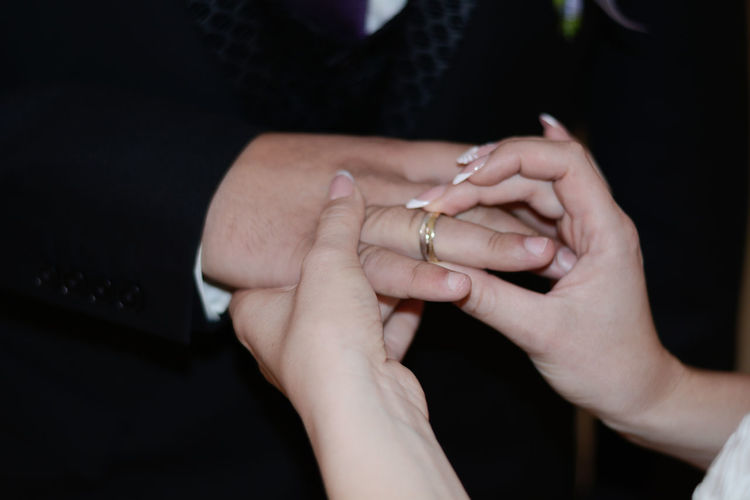 Bonding Bride Bridegroom Celebration Close-up Connection Couple - Relationship Engagement Ring Heterosexual Couple Holding Hands Human Body Part Human Hand Husband Love Married Men Ring Romance Togetherness Two People Wedding Wedding Ceremony Wedding Ring Wife Women