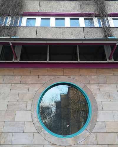 Low angle view of glass window on building