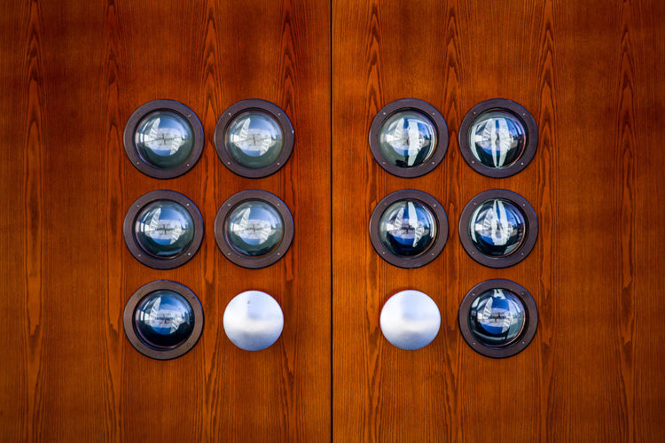 Close-up of coins on wooden door