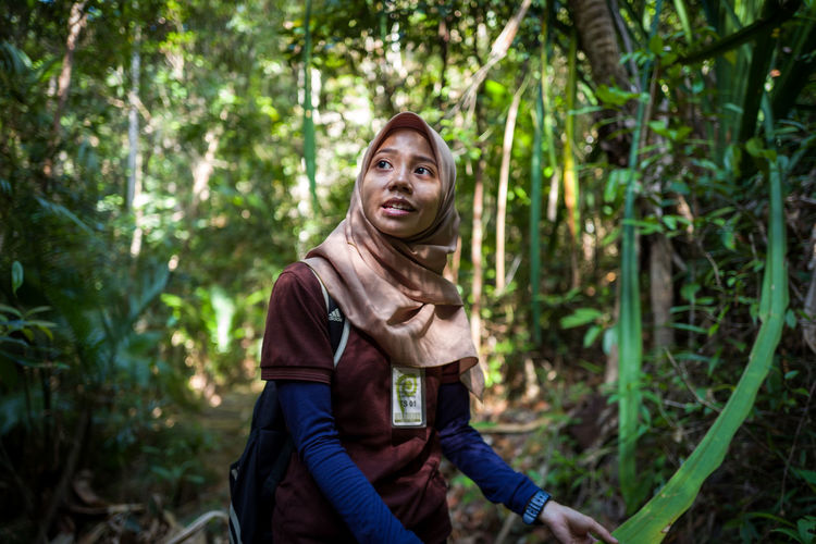 Langkawi Forest Tree Young Adult Land Three Quarter Length One Person Plant Portrait Looking At Camera Adult Casual Clothing Nature Leisure Activity Smiling Real People Lifestyles Sitting Front View Outdoors WoodLand Contemplation Beautiful Woman