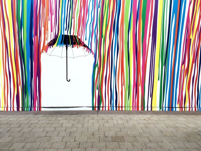 A mural the mall put up on one of their vacant stores Umbrella Dripping Paint Dripping Colors Colorful Wall