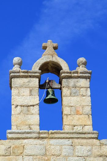 Bell Architecture Belief Bell Bell Tower Blue Building Building Exterior Built Structure Clear Sky Day Full Frame History Low Angle View No People Outdoors Place Of Worship Religion Sky Spirituality Stone Wall The Past