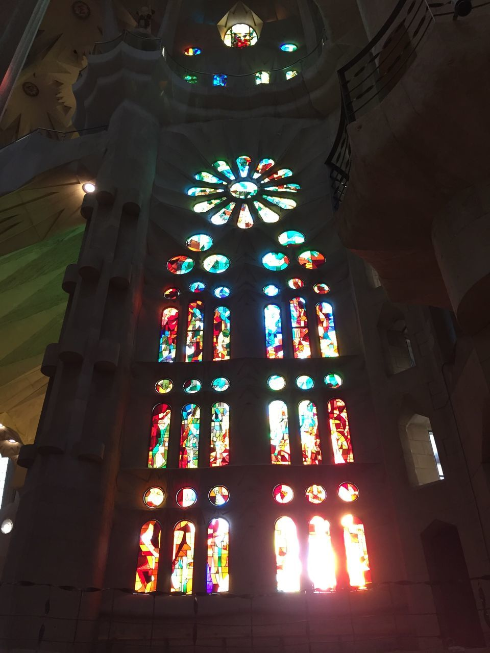 religion, place of worship, window, low angle view, indoors, architecture, multi colored, spirituality, built structure, illuminated, no people, day