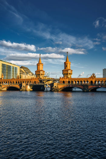 Popular Oberbaum bridge traversing Spree river Architecture City Copy Space Friedrichshain Historical Building Kreuzberg Spree Tourist Attraction  Arch Brick Building Bridge - Man Made Structure Building Exterior Building Structure Cloud - Sky Connection Day Landmark Outdoors River Sky Tourist Destination Towers Travel Destinations Water Waterfront