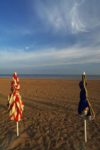 SUNRISE Beach Cloud - Sky Horizon No People Sand Sea Sky Tranquility Umbrellas On The Beach