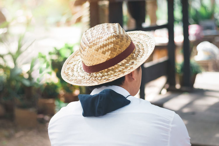 Rear view of man in hat