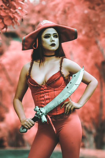 Infrared Camera 720nm 720nm EyeEm Best Shots Fashion Pirate Standing Infrared Photography One Woman Only Outdoor Photography Outdoors Portrait Red Color Weapon Women EyeEmNewHere EyeEmNewHere The Week On EyeEm