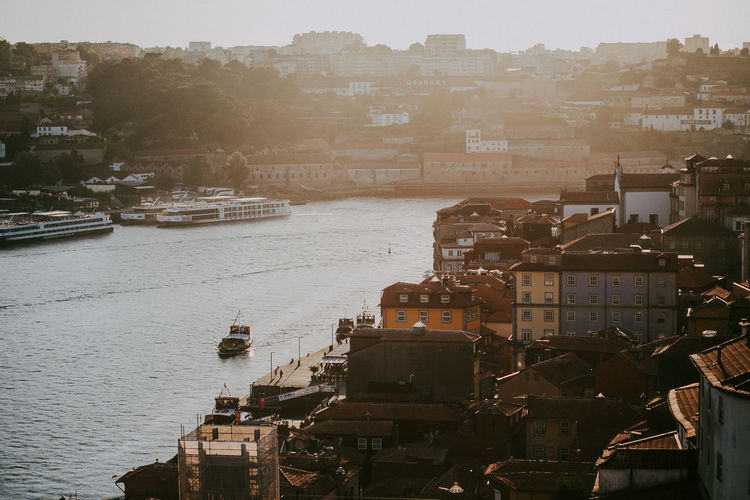 Building Exterior TOWNSCAPE Cityscape River Porto Portugal Mode Of Transportation Transportation High Angle View Nautical Vessel Outdoors Sunset Sunlight And Shadow Sunlight Sun Pier