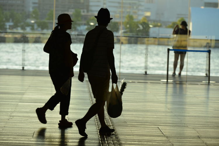 Man and woman walking together with polythene bags
