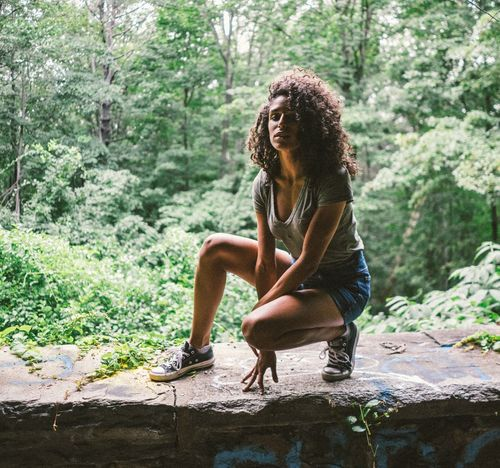 Forest Only Women Tree One Person Day Nature Sitting People Outdoors Curly Hair Adult Adults Only Full Length One Woman Only Adventure Human Body Part Young Adult Young Women One Young Woman Only