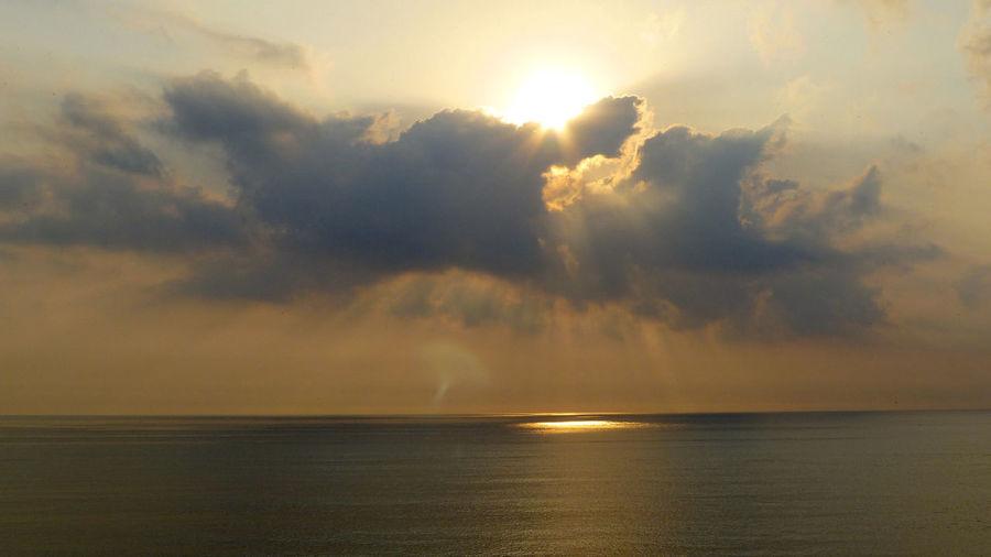 Majestic Sunburst Over Calm Sea