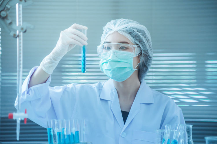 Close-Up Of Female Scientist Experimenting In Laboratory