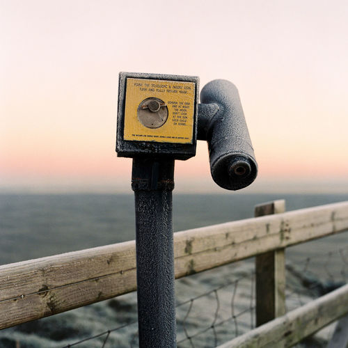 Coin-operated binoculars are covered in frost on a wintry morning along Northern Ireland's north coast. Frost Giant's Causeway Northern Ireland United Kingdom Wintry Binoculars Clear Sky Coin-operated Binoculars Cold Day Focus On Foreground Horizon Over Water Irish Metal No People Observing Outdoors Pastel Colors Railing Sea Sky Sunrise Travel Destinations Viewing Water