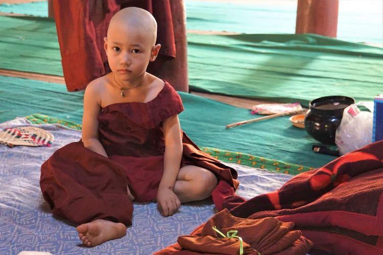 Portrait Of Monk Sitting On Blanket