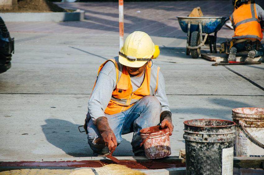 Builder of sidewalks in ravine, Lima - Peru Concrete Site Builder Cement Building Work Hand Paving Contruction Sidewalk Industrial Street Pouring Spreading Trowel Concreting Worker Pour Tool Job Floor Service Occupation Men Working