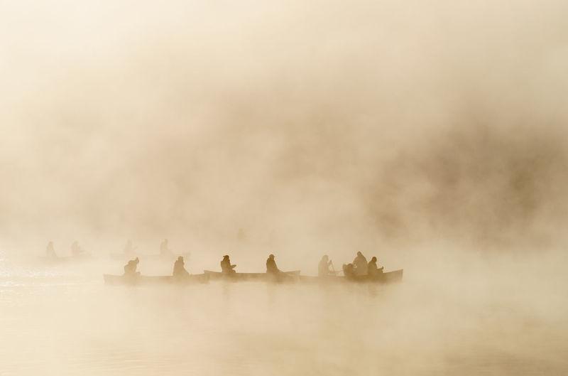 People in water against sky