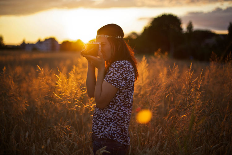 Alive  Camera Cereal Plant Field Field Freedom Goldenhour Nature Nature One Person Photo Photography Themes Portrait Rural Scene Sky Summer Sunset Taking Pictures Vintage Camera Wheat Woman