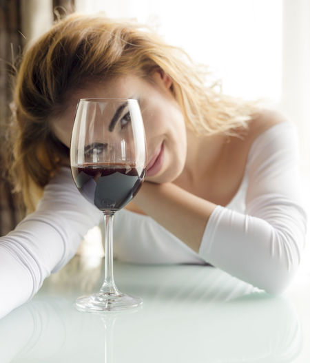 Wine Alcohol Drink Refreshment Wineglass One Person Glass Food And Drink Real People Indoors  Lifestyles Young Adult Sitting Table Young Women Portrait Hair Leisure Activity Red Wine Hairstyle Beautiful Woman