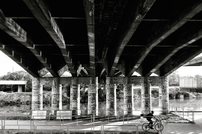 Bicycle Blackandwhite Monochrome Mobility In Mega Cities Bridge - Man Made Structure Architecture Connection Built Structure Below Transportation Underneath Architectural Column Outdoors Girder Day
