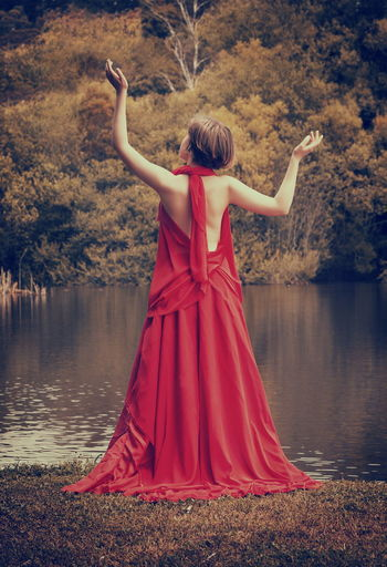 Adult Day Full Length Lake Lifestyles Nature One Person Outdoors People Real People Rear View Red Sky Standing Tree Water Women Young Adult Young Women