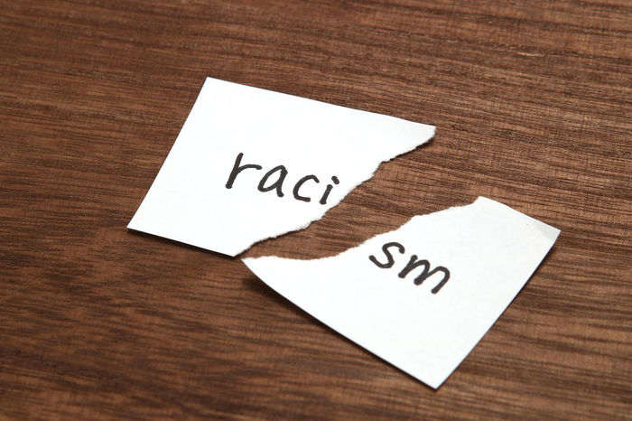 Cut Diversity Innovation Peace Protest Racism Rights Communication Concept Conflict Discrimination Elimination Equality Handwriting  Harassment Hate Ideas Indoors  Message Note Paper Problem Racial Text Wood - Material