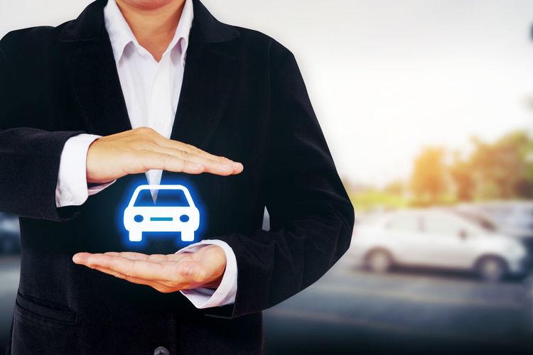 Digitally generated image of man holding car